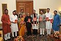 "Pranab Mukherjee received a copy of the book entitled ""India-The Future is Now"" from the Minister of State for Human Resource Development, Dr. Shashi Tharoor along with other Members of Parliament, at Rashtrapati Bhavan.jpg"