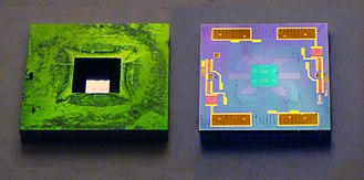Pressure sensor - Front and back of a silicon pressure sensor chip. Note the etched depression in the front; the sensitive area is extremely thin. The back side shows the circuitry, and rectangular contact pads at top and bottom. Size: 4x4 mm.