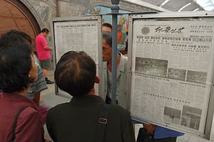 Media of North Korea - A public newspaper reading stand in Pyongyang