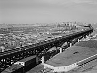 The Pulaski Skyway connects Newark to Jersey City and New York City .