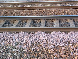 Track ballast trackbed upon which railroad ties are laid