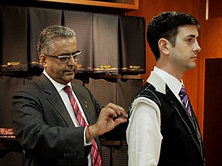 Tailor person who makes, repairs, or alters clothing professionally, typically mens clothing