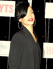 A woman with black hair dressed in a black outfit