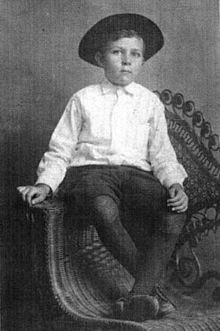 Robert E. Howard at five years old, dressed as a cowboy.