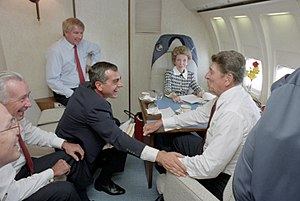 Ken Khachigian - Khachigian with President Ronald Reagan, First Lady Nancy Reagan, press secretary Larry Speakes, chief of staff Don Regan, and aide Dennis Thomas aboard Air Force One circa 1986.