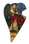 Rose window of Sainte-Chapelle (Paris) - Tuba angel (3).jpg