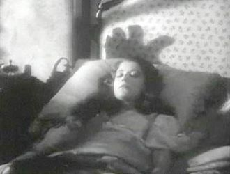 Murders in the Rue Morgue (1932 film) - Erik enters Camille's room, with the shadow of his hand appearing over her head.