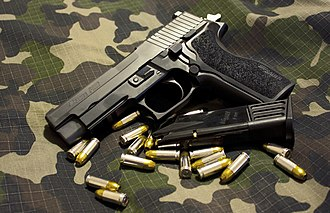 SIG Sauer P226 - SIG Sauer P226 E2. Note magazine capacity in this picture is capped at 10 rounds.