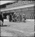 San Bruno, California. Families of Japanese ancestry arrive at assembly center at Tanforan Race Tra . . . - NARA - 537485.tif
