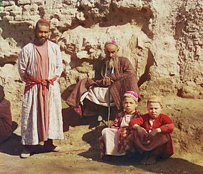 Two Sart men and two Sart boys in Samarkand, c. 1910 Sartscrop.jpg