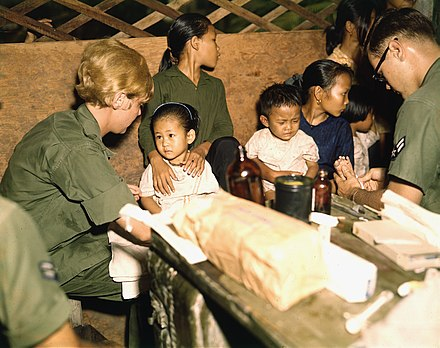 A nurse treats a Vietnamese child, 1967 Second Lieutenant Kathleen M. Sullivan treats a Vietnamese child during Operation MED CAP, a U.S. Air Force civic... - NARA - 542331.jpg