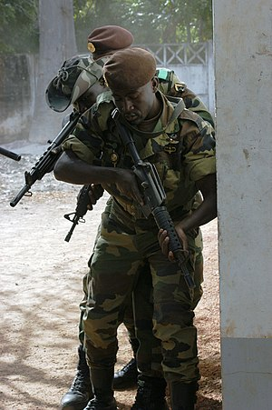 Armed Forces of Senegal - Senegalese soldiers enter a building during a training exercise.