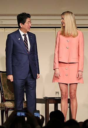 Clothing - Advisor to US President and businesswoman Ivanka Trump (right) along with Japanese PM Shinzo Abe wearing Western-style business suits as per their gender, 2017