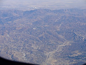 Soledad Canyon - Aerial view of Soledad Canyon, with the Antelope Valley Freeway winding up through it from Santa Clarita toward Palmdale. Agua Dulce is visible in the center of the image, just left of the freeway.