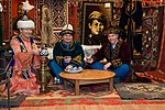Soyuz MS-08 backup crew during a traditional Kazakh meal.jpg