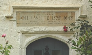 John White (colonist priest) - Carved plaque over the door of the 16th century house in Stanton St. John, Oxfordshire where John White was born.