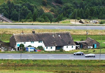 Stott Hall Farm, viewed from moorland above westbound carriageway Stott Hall Farm (crop).JPG