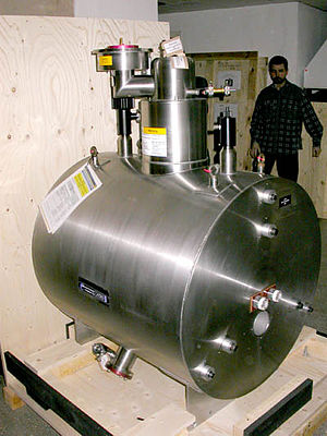 Superconducting magnet - 7 T horizontal bore superconducting magnet, part of a mass spectrometer. The magnet itself is inside the cylindrical cryostat.