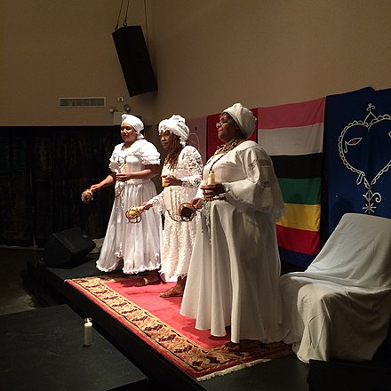 A Vodou ceremony taking place at the National Black Theatre in New York City in 2017 Swearing-in ceremony of Diaspora GwetoDe by Konfederasyon Nasyonal Vodou Ayisyen 07.jpg