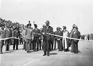 Philip Game - Ribbon ceremony to open the Sydney Harbour Bridge on 19 March 1932. Premier Lang cuts the ribbon while Game looks on.