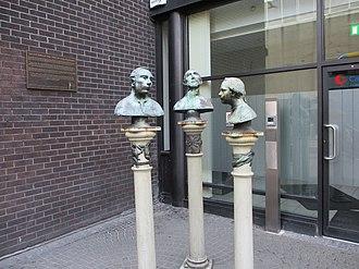 Abbey Street - Talking Heads sculpture near the National Lottery offices on Abbey Street Lower