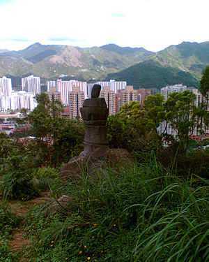 Cantonese folktales - The replica of Amah Rock at Tao Fung Shan; According to Cantonese legends, a woman turned into a stone statue by standing at the seaside waiting for her husband to return home.