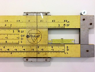 Educational technology - A 2.5m teaching slide rule compared to a normal sized model