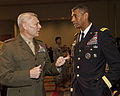 The Assistant Commandant of the Marine Corps, Gen. John M. Paxton, Jr., left, speaks with Army Gen. Vincent K. Brooks during the Association of the United States Army (AUSA) Conference in Washington, D.C 131023-M-KS211-004.jpg