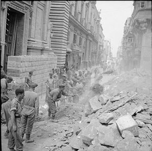 Auberge de Provence - Auberge de Provence surrounded by rubble from bombed buildings, 11 May 1942.
