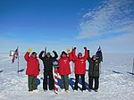 The IceBridge team and members of the 109th AW strike a pose at the South Pole.jpeg