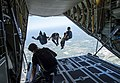 The Leap Frogs exit a C-130 Hercules, during a skydiving demonstration in Gulfport-Biloxi. (33745313121).jpg