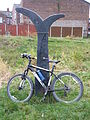 "The National Cycle Network ""fossil tree"" milepost on the Fallowfield Loop (8200730238).jpg"