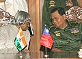 The President, Dr. A.P.J. Abdul Kalam in conversation with the Senior General Than Shwe during a meeting at the Parliament House building in Yangon, Myanmar on March 9, 2006.jpg