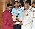 The President, Shri Ram Nath Kovind presenting the Arjuna Award, 2018 to Shri Sumit for Wrestling, in a glittering ceremony, at Rashtrapati Bhavan, in New Delhi on September 25, 2018.JPG