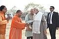 The Prime Minister, Shri Narendra Modi being seen off by the Governor of Uttar Pradesh, Shri Ram Naik and the Chief Minister, Uttar Pradesh, Yogi Adityanath on his departure from Botanical Garden, Noida, Uttar Pradesh.jpg