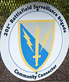 The crest of the U.S. Army 201st Battlefield Surveillance Battalion is displayed on a community connector sign in Gig Harbor, Wash., May 24, 2012 120524-A-FS521-004.jpg
