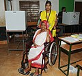 The physically handicapped woman voter, at a polling booth to cast her vote, during the 5th Phase of General Elections-2014, at Central- Bhubaneswar, Odisha on April 17, 2014.jpg