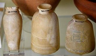 Tjebu - Three alabaster granary vases. 5th Dynasty. From Qau (Tjebu, Qaw El Kebir, Antaeopolis), Egypt. The Petrie Museum of Egyptian Archaeology, London