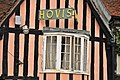 Timber framed house bay window and Hovis sign, Lavenham, Suffolk.jpg