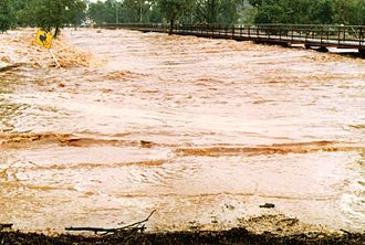 Todd River - Todd River during a rare flood event, Wills Terrace Causeway, Alice Springs, 31 March 1988