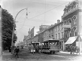 Horse-drawn streetcars in 1890. The city's streetcar system transitioned to electric-powered streetcars in 1892. Toronto Street Railway Co. horse-car 145 on King street. View from Church street.jpg