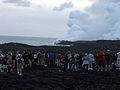 Tourists are looking at Waikupanaha lava ocean entries.jpg
