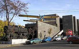 Hungarian Technical and Transportation Museum - Locomotives and an Antonov An-2 aircraft outside newly demolished building of the Hungarian Museum of Science, Technology and Transport