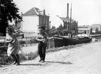 Towpath - People towing a vessel in the Netherlands in 1931