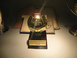 Football-shaped trophy, mounted on a base