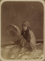 Troupe of Musicians. A Woman Holding a Dayra, or Frame Drum WDL11114.png