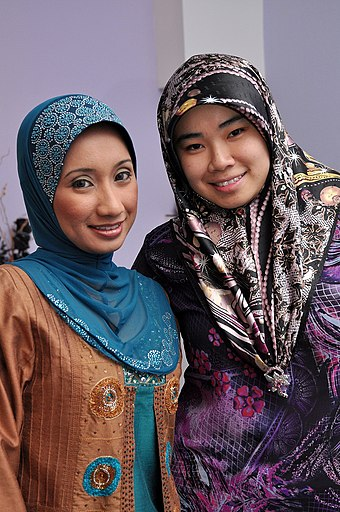 Women wearing tudungs (the Malay term for hijab) in Brunei Two Muslim women in tudungs at an engagement party, Brunei - 20100531.jpg