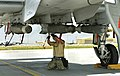 U.S. Air Force Staff Sgt. Brian Chatham, a weapons load crew chief with the 455th Expeditionary Aircraft Maintenance Squadron, secures munitions to an A-10C Thunderbolt II aircraft at Bagram Airfield, Parwan 130611-F-IW762-368.jpg