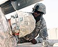 U.S. Army Sgt. Bryan Brown, background, helps secure a part of a simulated downed aircraft onto a truck during a training exercise at Contingency Operating Base Adder, Iraq, July 5, 2011 110705-A-FE031-004.jpg