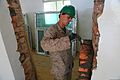 U.S. Marine Corps Lance Cpl. Christopher Cornelison, an intelligence chief with 9th Engineer Support Battalion, 3rd Marine Logistics Group, lays brick while working with a multinational team of engineers to 130726-M-MG222-006.jpg